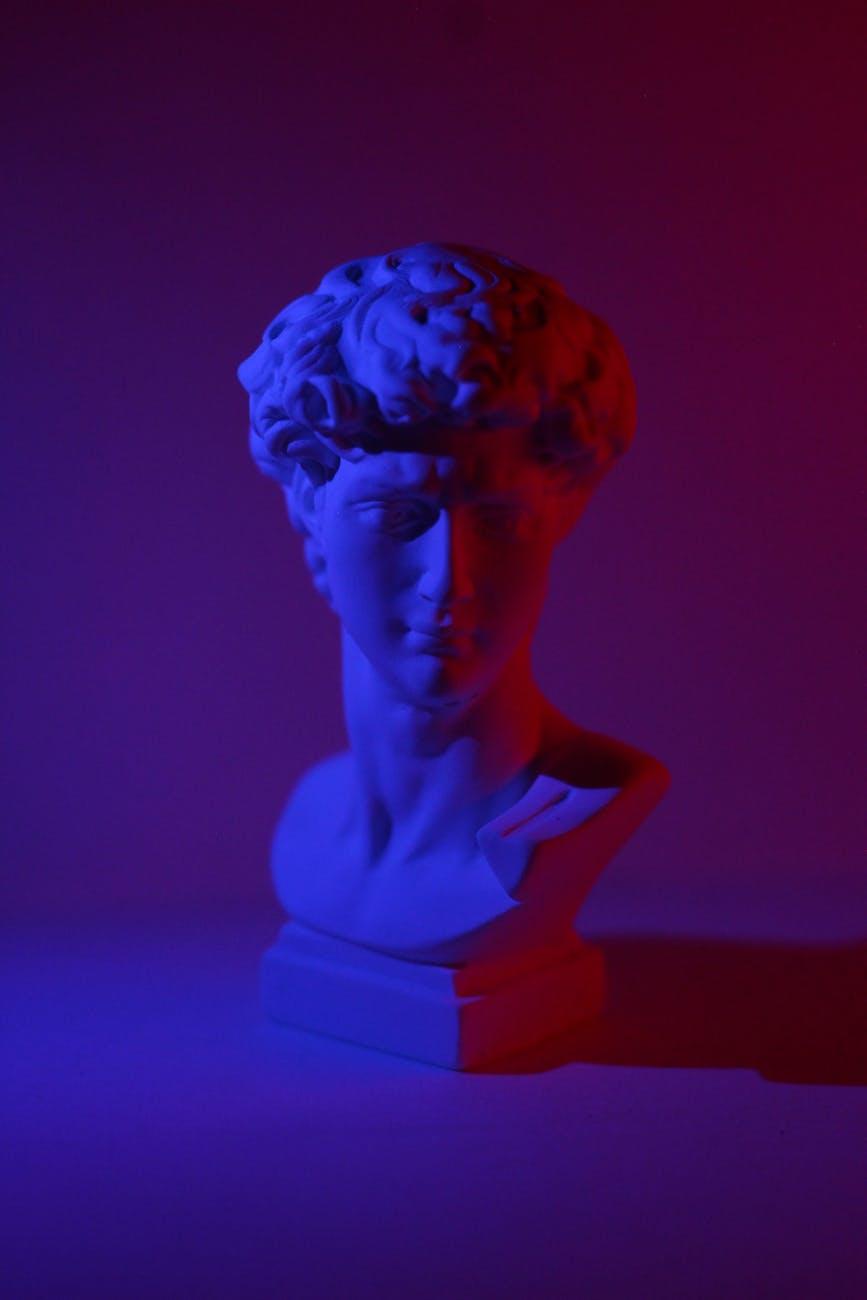 bust of young man in dark studio