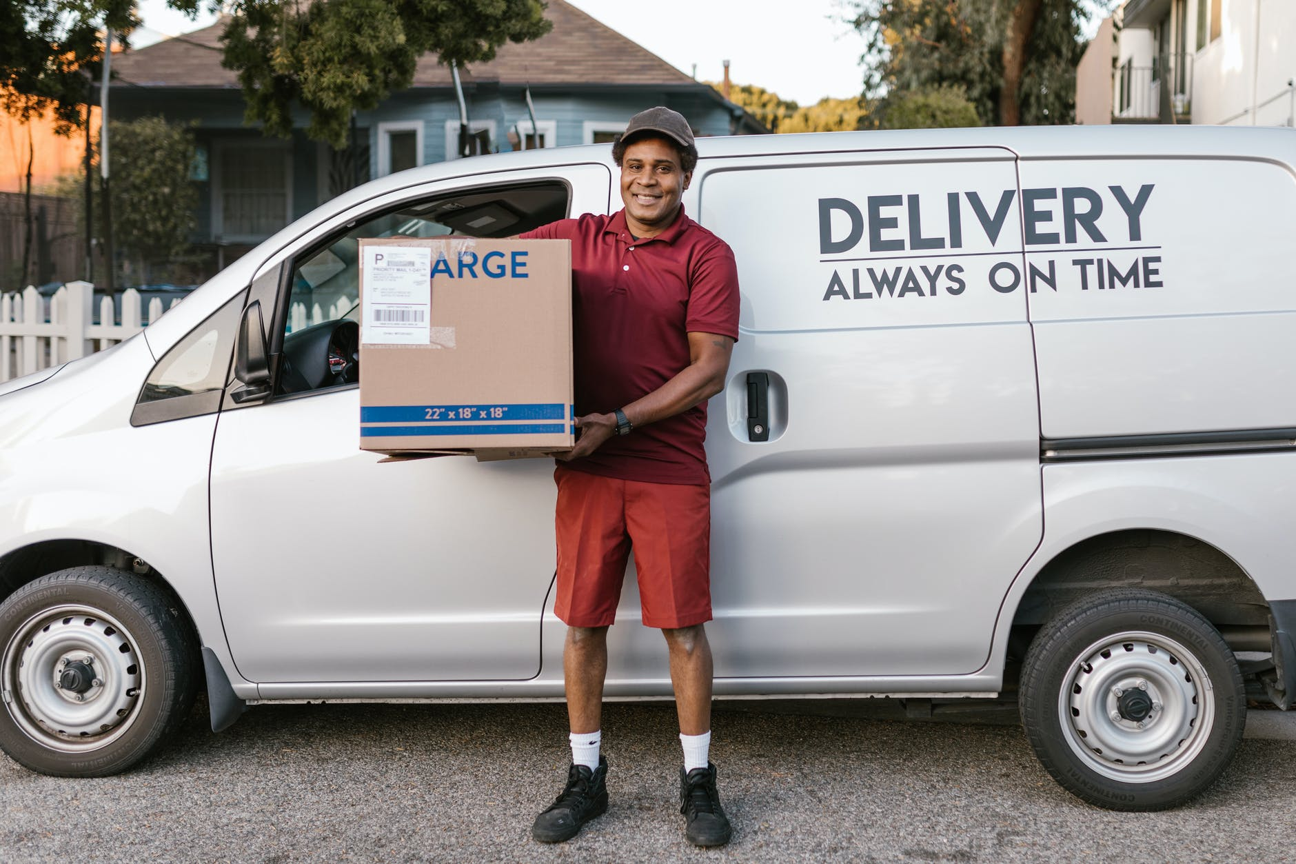 a deliveryman carrying a package